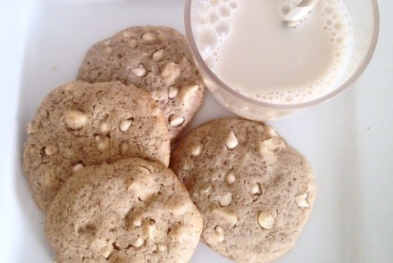 Made from scratch homemade vegan white chocolate macadamia nut cookies with a cold glass of almond mylk